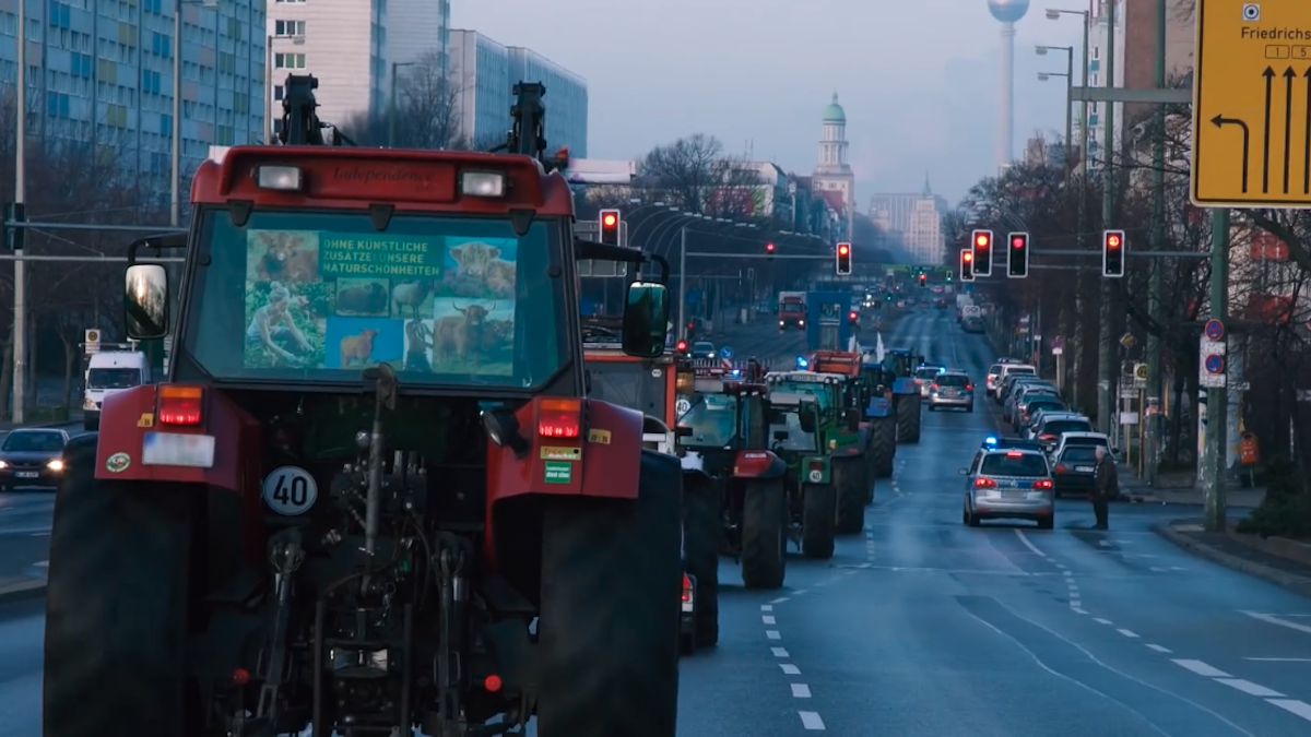 A still from the short film WEUNITE shows farmers driving their tractors to the We Are Fed Up demonstration in Berlin.